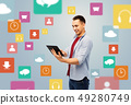 happy young man with tablet over media icons 49280749