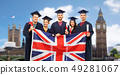 graduate students with diplomas and british flag 49281067