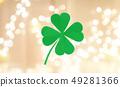 green paper four-leaf clover over festive lights 49281366