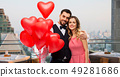 couple with heart shaped balloons in singapore 49281686