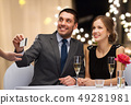 happy couple at restaurant paying by credit card 49281981