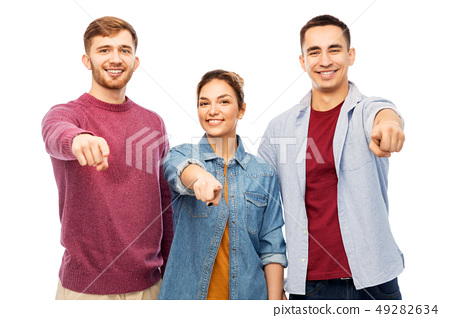 group of smiling friends pointing at you over 49282634