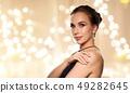 beautiful woman in black wearing diamond jewelry 49282645