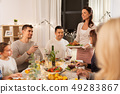 happy family having dinner party at home 49283867