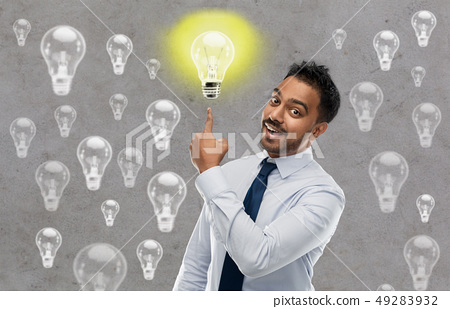 indian businessman pointing finger at light bulb 49283932