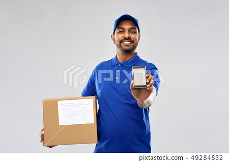 indian delivery man with smartphone and parcel box 49284832
