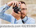 photographer or hipster with film camera outdoors 49285069