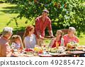 happy family having dinner or summer garden party 49285472