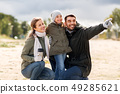 happy family outdoors in autumn 49285621