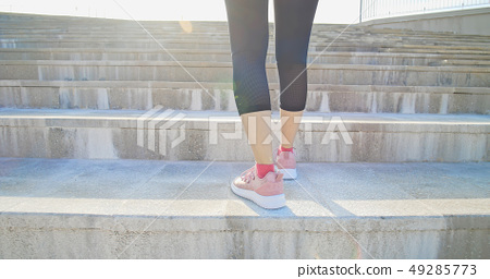 woman ready to run on stairs 49285773