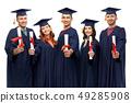 graduates in mortar boards with diplomas 49285908