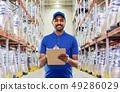 indian delivery man with clipboard at warehouse 49286029