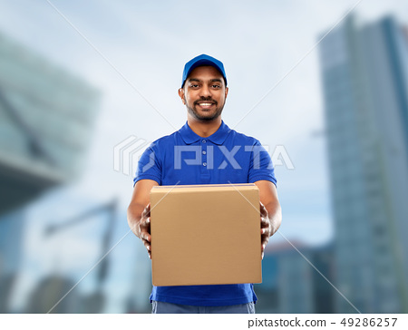 happy indian delivery man with parcel box in blue 49286257