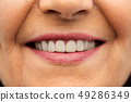 close up of senior woman smiling mouth and teeth 49286349