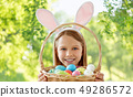happy girl with colored easter eggs 49286572