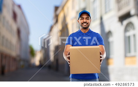 happy indian delivery man with parcel box in city 49286573