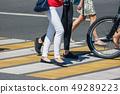 pedestrians at a pedestrian crossing 49289223