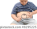 Obese boy overweight  holding magnifying glass 49295225