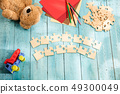 Concept of mock up and pieces of puzzles on the background of wooden table 49300049