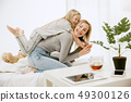 Young mother and her little daughter hugging and kissing on bed 49300126