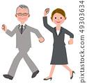 Senior man and woman walk 49303634