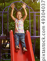 Asian girl on a slide at a park 49304037