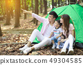 happy Family Enjoy Camping Holiday In Countryside 49304585