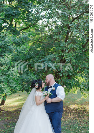 Newlyweds on their wedding day are walking in the 49306274