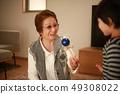 Senior lady and boy playing with kendama 49308022