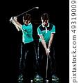 Golfer man golfing golf swing isolated black background multiple exposure 49319009