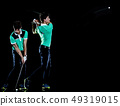 Golfer man golfing golf swing isolated black background multiple exposure 49319015