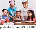 Happy boy in party hat with birthday cake 49321909