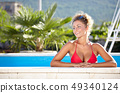 Portrait of a sexy woman relaxing in a swimming 49340124