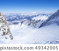 Winter landscape with free ride piste and view on snow covered slopes and blue sky, with Aerial view 49342005