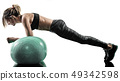 woman pilates fitness swiss ball exercises silhouette isolated 49342598