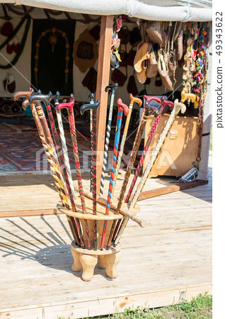 Colorful decorative wooden walking sticks on 49343622