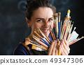 artist art supplies woman paintbrushes tools fan 49347306