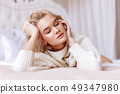 Blonde woman with short hair cut closing eyes feeling satisfied 49347980