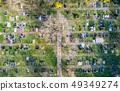 Aerial drone view of a church graveyard cemetary Germany 49349274