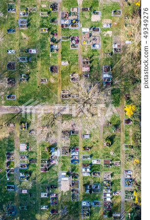 Aerial drone view of a church graveyard cemetary Germany 49349276