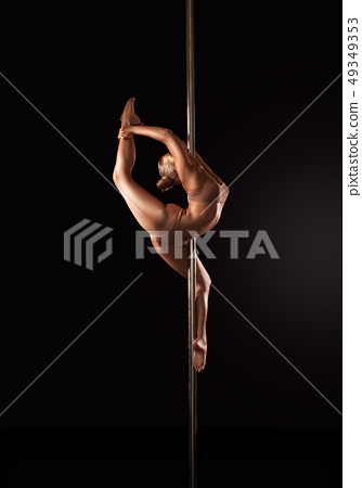 Sensual woman dancing on pole 49349353