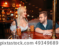 Surprised drunk man stairs at breasts of waitress 49349689