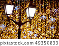 Street lantern with decorative Christmas garlands. 49350833