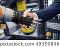 Hand of a businessman shaking hands with a Android 49350846