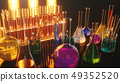 Chemical reaction, flasks with different laboratory glassware and liquid for analysis. Scientific 49352520