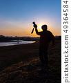 拍一张美丽的风景照片的摄影师人 49364584