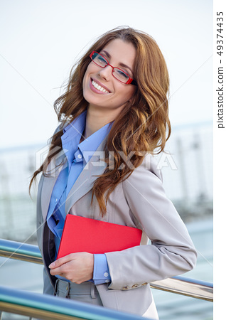 Attractive Real Estate Agent Woman 49374435