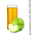 Glass of apple juice and cut apples isolated on white background 49378436