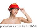 Portrait of confident female worker in orange helmet 49381658
