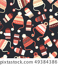 Seamless vector background with hats and mittens. Contemporary seasonal winter pattern tile with 49384386